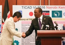 Kenyan President Uhuru Kenyatta (R) shakes hands with Katsuyuki Kawai, the Special Representative of the Prime Minister of Japan to the AU Summit, during a press conference in Addis Ababa, capital of Ethiopia, on Jan. 31, 2016. The sixth Tokyo International Conference on African Development (TICAD) will be held in Kenya from August 27 to 28th, President Uhuru Kenyatta announced Sunday on the sidelines of the AU heads of State Summit in Addis Ababa. (Xinhua/Pan Siwei)