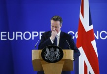 British Prime Minister David Cameron addresses a press conference at the end of an extraordinary two-day EU summit at the European Council in Brussels, Belgium, Feb.19, 2016. European leaders on Friday night reached a deal on British Prime Minister David Cameron's reforms after marathon talks, President of the European Council Donald Tusk tweeted. (Xinhua/Ye Pingfan)