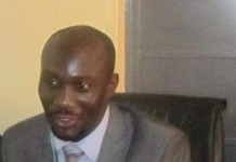 Dr. Fred Adomako,