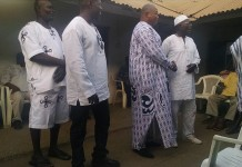 Mr Benjamin Kojo Anang Yemoh (middle) the newly installed Nii Leshie, being congratulated