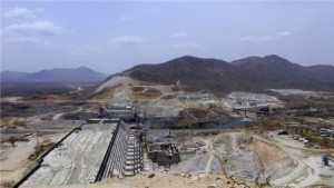 Even before the impact studies have been started, officials say 50 percent of the dam's construction has been completed [Reuters]
