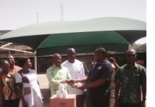 The Programme Manager of CCFC, Mr Evans Sinkari , donating the items to the Regional Health Director of GHS, Dr Kofi Issah..png20595