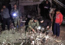 Syrian army soldiers inspect the site of a series of attacks in the district of Sayyidah Zaynab, south of Damascus, Syria, Feb. 21, 2016. The death toll in the triple bombings that rocked a Shiite district in Damascus on Sunday has risen to 83, state news agency SANA said. As many as 178 others were injured in these serial attacks. [Xinhua/Yang Zhen]