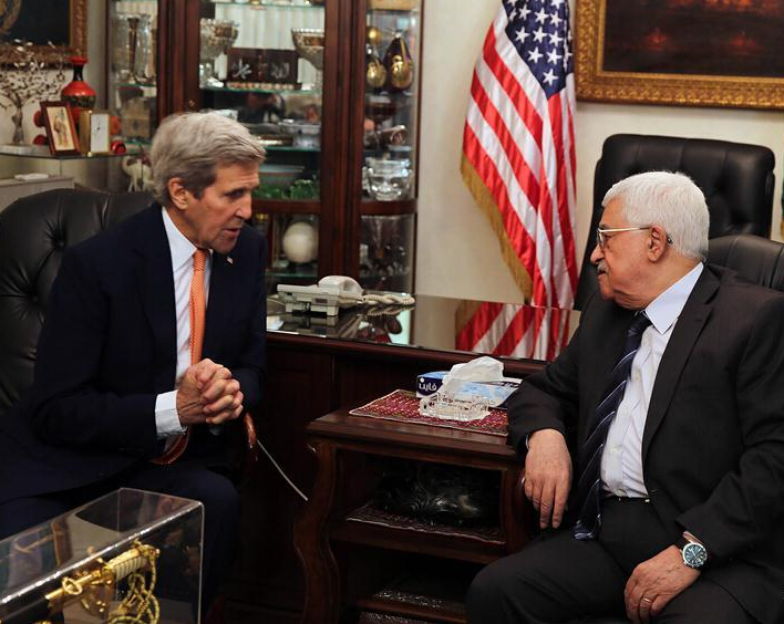 U.S. Secretary of State John Kerry meets with Palestinian President Mahmud Abbas (R) at the Palestinian ambassador's residence in Amman, Jordan, Feb. 21, 2016. [Xinhua/EPA/POOL/JAMAL NASRALLAH]