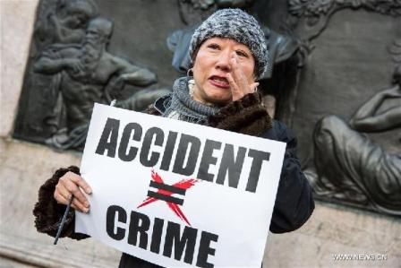A woman in tears speaks to the press during a rally in support of New York City Police officer Peter Liang, at Brooklyn's Cadman Plaza Park, in New York, the United States, Feb. 20, 2016. Peter Liang, a New York City police officer of Chinese descent, was found guilty on Feb. 11 of manslaughter over the shooting of a black man, prompting concerns of discrimination. On Nov. 20, 2014, Liang, a 27-year-old with only a year and a half on the job, was patrolling with his partner in Brooklyn's East New York housing project when he was startled by a noise. In a stairway that prosecutors described as