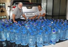 GMSA employees donated water to people living in drought-stricken areas. Rene Mostert (left) and Vaughn Barry (right) counted the water before loading it on to the truck destined for Barkley East and Rhodes.