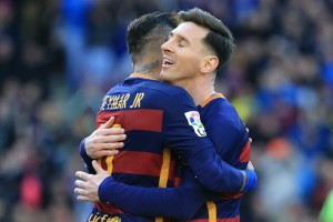 Barcelona's Neymar (L) hugs Lionel Messi to celebrate after scoring during the Spanish first division football match between FC Barcelona and Getafe CF at Camp Nou Stadium in Barcelona, Spain, March, 12, 2016. FC Barcelona won 6-0. (Xinhua/Pau Barrena)