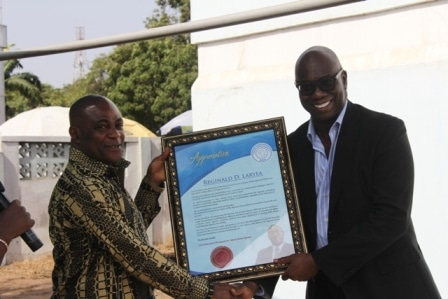 Mr Reginald D. Laryea, former Board Chairman of the Ghana News Agency (right) receiving the citation at the awards ceremony.