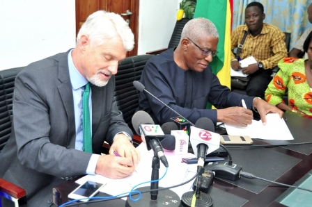 Nii Osa Mills, Minister of Lands and Natural Resource and Mr William Hanna, EU Ambassador to Ghana signing the agreement.
