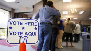 Voters stand in line to cast their ballots inside Calvary Baptist Church March 1, 2016 in Rosenberg, Texas