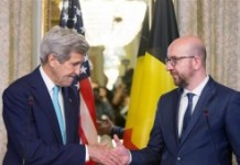 US Secretary of State John Kerry (L) shakes hands with Belgian Prime Minister Charles Michel after delivering a joint statement at the Belgian Prime Minister's residence in Brussels on March 25, 2016.