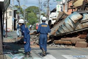 KUMAMOTO, April 17, 2016 (Xinhua) -- Firefighters check the buildings in the earthquake rocked Mashiki in Kumamoto prefecture, Japan, April 17, 2016. A powerful magnitude-7.3 earthquake struck the island of Kyushu in southwestern Japan early Saturday just a day after a sizable foreshock hit the region, with the number of fatalities now standing at 41 according to the latest figures on Sunday. (Xinhua/Ma Ping)