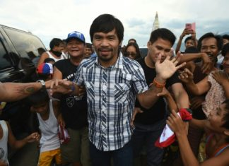 AFP / Ted Aljibe Boxing legend Manny Pacquiao smiles as he soaks up the sounds of adoring fans screaming his name, their cheers heralding a new career as one of the Philippines' most powerful politicians.