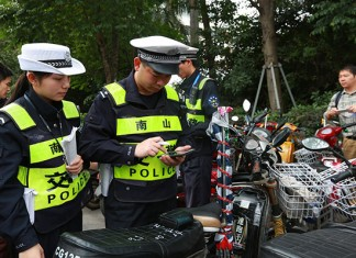 Traffic police officers in Shenzhen, Guangdong province, seize unlicensed electric bikes and freight tricycles in March. [Photo/Xinhua]