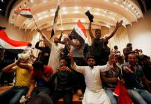 The Shia protesters unfurled banners after storming parliament