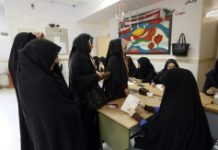 Iranian women vote in the second round of parliamentary elections at a polling station in the town of Robat Karim, southwest of the capital Tehran