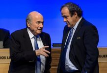 In this file picture taken on June 11, 2014 Fifa president Joseph Blatter talks to Uefa chief Michel Platini during the 64th Fifa congress in Sao Paulo Brazil. PHOTO | FABRICE COFFRINI | AFP
