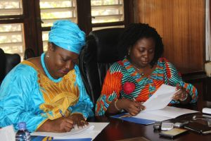 Minster  and the  Executive  Director  signing  the MOU