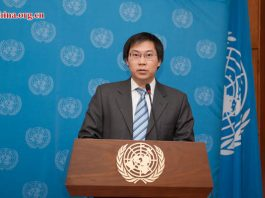 Vatcharin Sirimaneetham, an officer of economic affairs at ESCAP, briefs on the ESCAP report at the UN China headquarters in Beijing on April 28, 2016. [Photo by Chen Boyuan / China.org.cn]