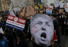 Getty/AFP/File / Eduardo Munoz Alvarez People take part in a protest against Republican presidential candidate Donald Trump, on March 19, 2016 in New York