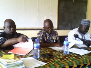 Mr Ibrahim Faila, Presiding Member of LaNMMA (right); Mr Franklin Anku, MCE (middle) and Alhaji Dramani Saaka, the Co-ordinating Director of LaNMMA