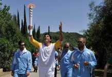 Olympic flame second torch bearer, former volleyball player Giovane Gavio from Brazil, attends the Olympic flame lighting ceremony for the Rio 2016 Olympic Games inside the ancient Olympic Stadium on the site of ancient Olympia, Greece, April 21, 2016.