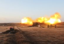 AFP / Omar haj kadour Rebel fighters from the Jaish al-Fatah (or Army of Conquest) brigades fire artillery during clashes with Syrian pro-government forces near the village of Om al-Krameel, in Aleppo's southern countryside