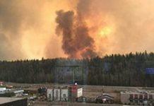 AFP Alberta Agriculture and Forestry Department photo shows smoke rising from a heavily wooded area on May 3, 2016 in the Canadian city of Fort McMurray