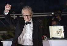 """British director Ken Loach poses with his trophy during a photocall after winning the Palme d'Or Award for the film """"I, Daniel Blake"""" at the 69th Cannes Film Festival in Cannes, southern France on May 22, 2016. (Xinhua/Jin Yu)"""