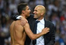 AFP / Gerard Julien Real Madrid forward Cristiano Ronaldo (L) and coach Zinedine Zidane celebrate after Real won the UEFA Champions League final over Atletico Madrid