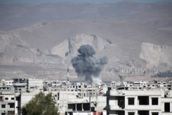 AFP/File / Amer Almohibany Smoke billows following reported air strikes by Syrian government forces in the eastern Ghouta region, a rebel stronghold east of the capital Damascus, on February 17, 2016