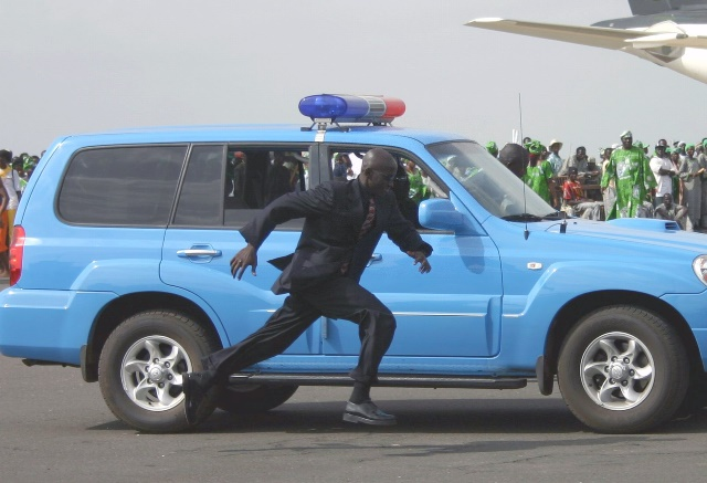 A Bodyguard Runs To Take Position At The International Airport In Banjul Capital Of Gambia