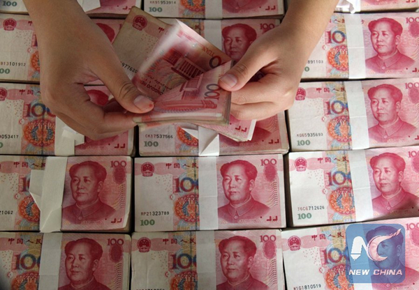 China's central bank injected 55 billion yuan (US$8.3 billion) into the money market on Tuesday to ease a liquidity strain. [Photo/Xinhua]