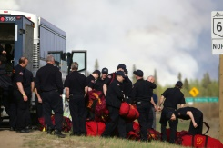AFP / Cole Burston More than 1,100 firefighters are battling 49 separate blazes across the Canadian province of Alberta, seven of them totally out of control