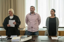 Pool/AFP / Jens Schlueter  Lutz Bachmann (C), co-founder of Germany's xenophobic and anti-Islamic PEGIDA movement, stands between his lawyer Katja Reichel (L) and his wife Vicky Bachmann (R) on May 3, 2016 in Dresden, eastern Germany