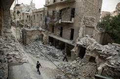 AFP/File / Karam Al-Masri A Syrian man walks past destroyed buildings in Aleppo's Bab al-Hadid neighbourhood on May 2, 2016