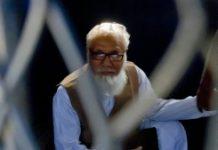 AFP/File / Tanvir Ahammed Leader of Bangladesh's Jamaat-e-Islami party Motiur Rahman Nizami sits inside a van as he is taken to a prison after being sentenced at the International Crimes Tribunal court in Dhaka, in October 2014