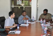 Dr Vanderpuije holding a meeting with the contractors and the consultant