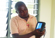 Mr Andrew Akiti displaying the fish finder equipment