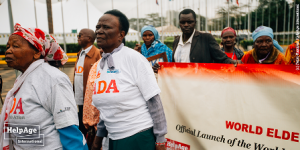 Mama Rhoda Ngima and Mama Esther Wamera (L-R respectively) join others on a street match calling on the rights of the older persons