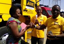 Mr Lolu Managing Director J.A Plant Pool handing over the key to Dr Justina Ansah.
