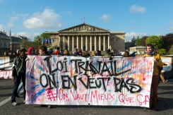"""AFP / Geoffroy Van der Hasselt  Members of the Nuit Debout movement hold a banner reading """"Labour reform, we don't want it"""" in front of the French parliament in Paris, on May 3, 2016"""