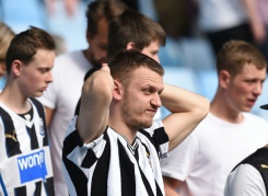 AFP / Paul Ellis Newcastle United supporters react to the news rivals Sunderland have won, consigning them to relegation from the English Premier League