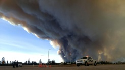 Alberta RCMP/AFP / RCMP Alberta Members of the Royal Canadian Mounted Police monitor the fires around Fort McMurray in Alberta, Canada