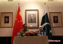 Pakistan's military spokesperson Lieutenant General Asim Saleem Bajwa (L) and Ambassador of Pakistan to China Masood Khalid (R) at a press conference in Beijing on May 17, 2016. [Photo by Gong Jie/China.org.cn]