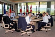 POOL/AFP / Carolyn Kaster (From L) David Cameron, Francois Hollande, Justin Trudeau, Jean-Claude Juncker, Shinzo Abe, Donald Tusk, Matteo Renzi, Barack Obama and Angela Merkel participate in a G7 working session in Shima