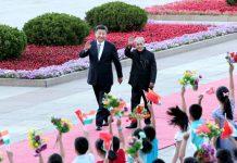 President Xi Jinping (left) welcomes visiting Indian President Pranab Mukherjee in Beijing on May 26, 2016. [Photo/Xinhua]