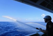 """A sailor is taking part in the fire drill on the Chinese patrol vessel """"Haixun 01"""" on April 8, 2016 in the South China Sea. [Photo/Xinhua]"""