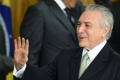AFP / Evaristo Sa Brazilian acting President Michel Temer wasted no time in putting his stamp on the country, naming a new cabinet consisting entirely of white males