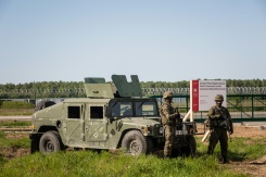 AFP / Wojtek Radwanski Soldiers stand guard during ground breaking ceremony of the northern section of defence anti-missile shield in Redzikowo military base in northern Poland, May 13, 2016